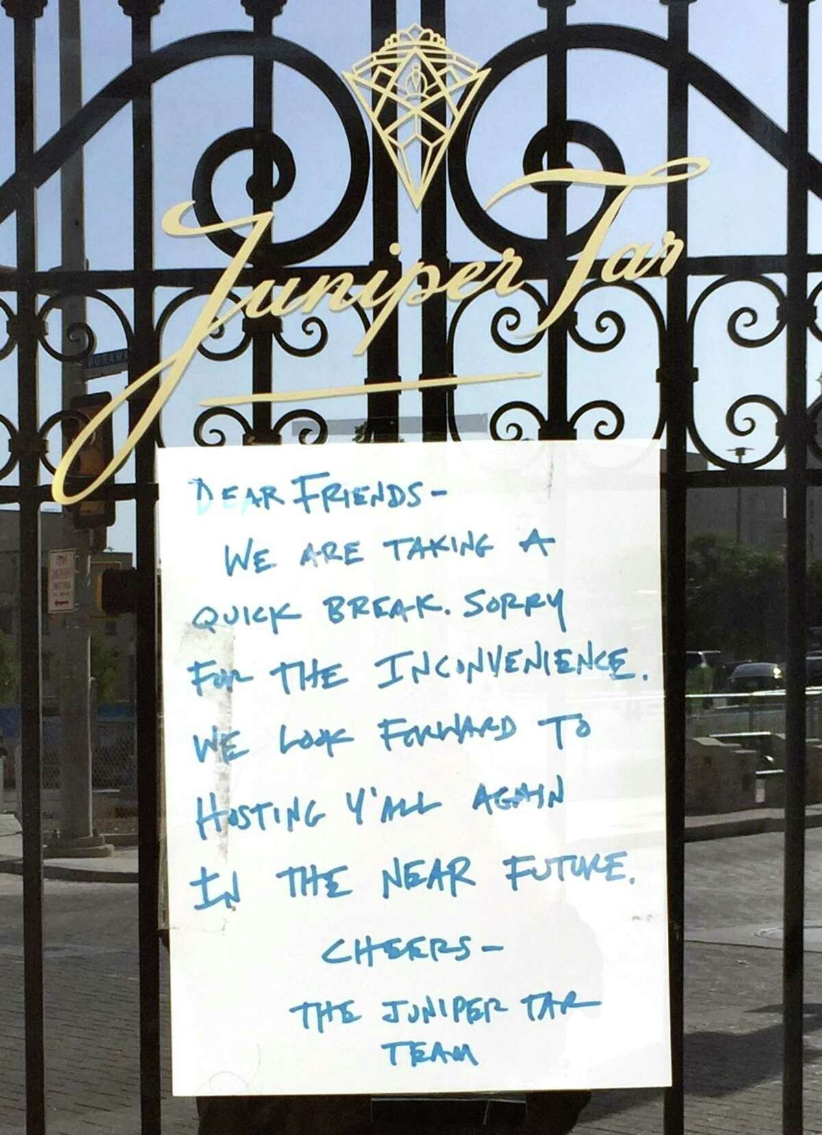 A sign posted on the door of Juniper Tar at 244 W. Houston St. indicates the bar is currently closed.