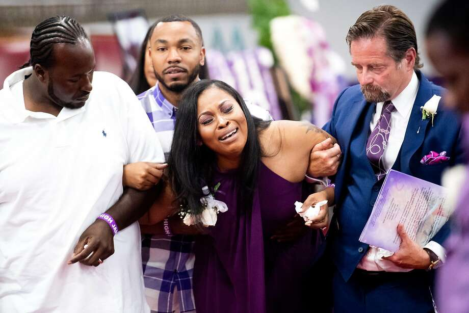 Marvin (left) and Nailah Winkfield leave Jahi McMath's funeral with attorney Christopher Dolan (right). Photo: Photos By Noah Berger / Special To The Chronicle