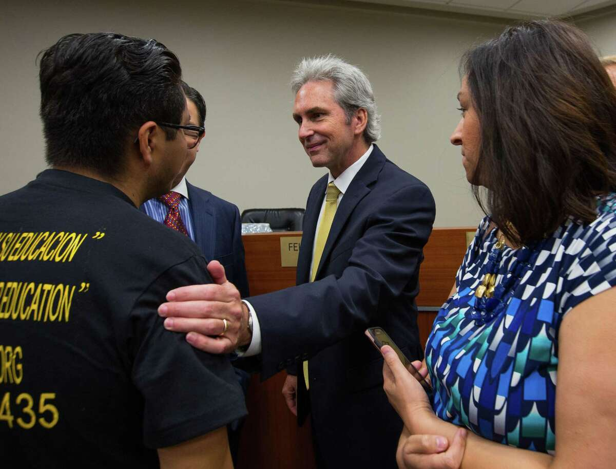 Pasadena Mayor Jeff Wagner greets Cesar Espinosa after being sworn into office at Pasadena City Hall, Saturday, July 1, 2017.