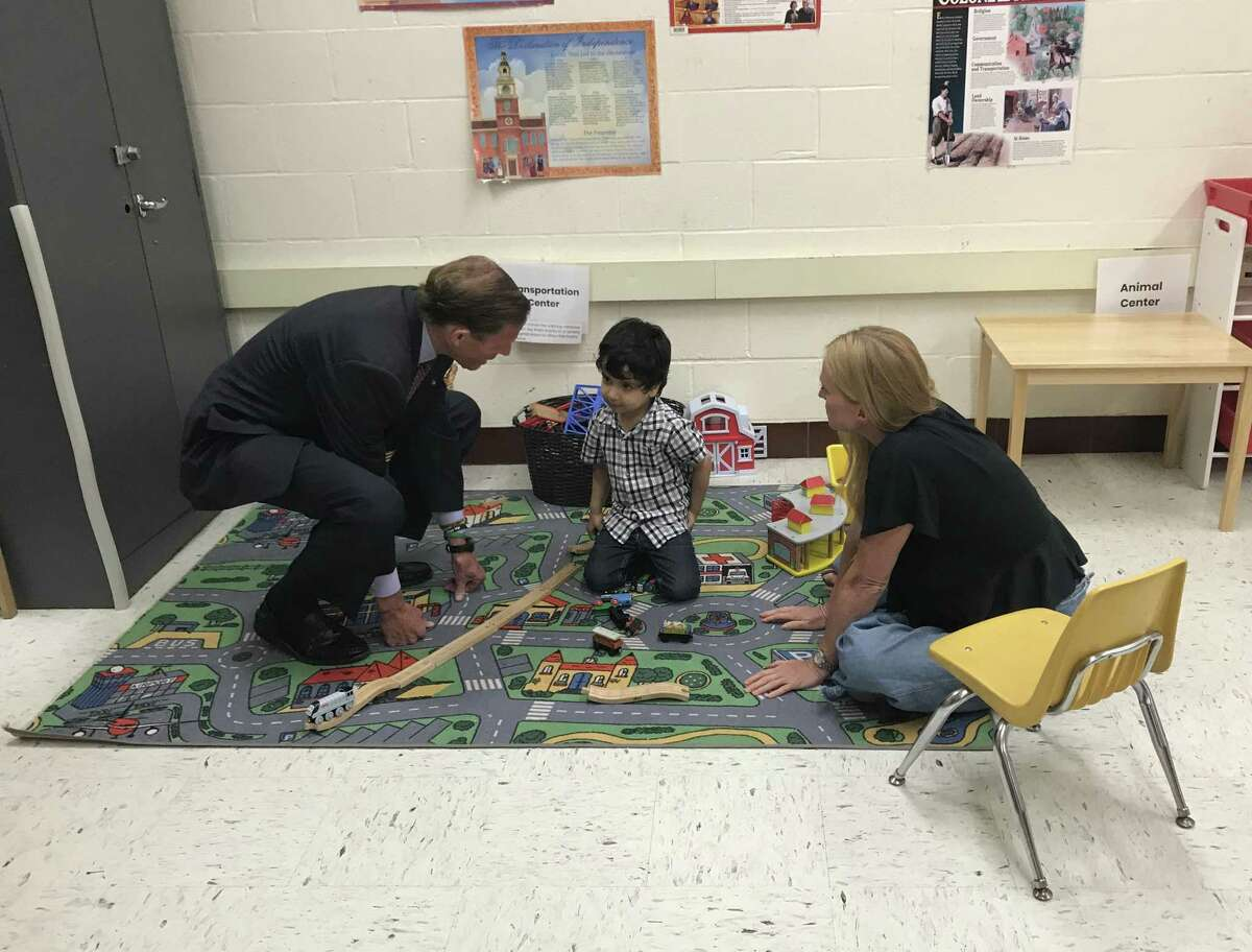 U.S. Sen. Richard Blumenthal, D-Conn., and volunteer Brenda DenOuden practice counting with 4-year-old Mohammed Friday at an Integrated Refugee & Immigrant Services summer learning program in New Haven.