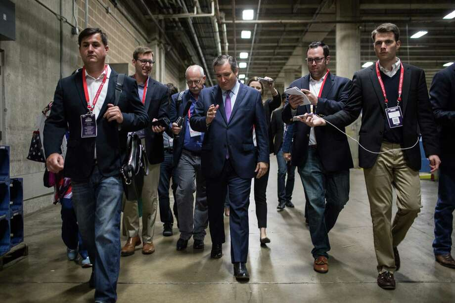 Sen. Ted Cruz, center, speaks to reporters at the Texas Republican Convention in San Antonio on June 16. His campaign has run afoul of the Federal Elections Commission. Photo: TAMIR KALIFA /NYT / NYTNS