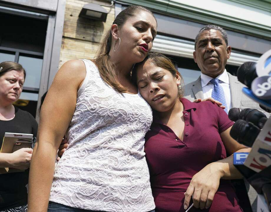 Yeni Gonzalez, a Guatemalan mother who was separated from her three children at the U.S.-Mexico border, right, is embraced by volunteer Janey Pearl during a news conference Tuesday in New York. Poetry can help us understand their plight. Photo: Craig Ruttle /Associated Press / FR61802 AP