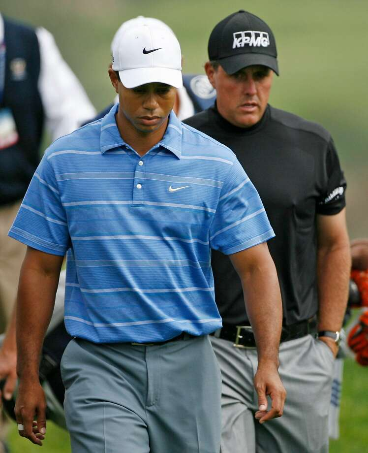 Phil Mickelson walks behind Tiger Woods down the fifth fairway during the first round of the US Open championship at Torrey Pines Golf Course on Thursday, June 12, 2008 in San Diego. (AP Photo/Denis Poroy) Photo: Denis Poroy / Associated Press