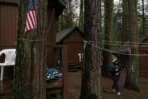 Michelle Tom walks through the trees from her cabin to find her family July 9, 2015 at Mather Family Camp in Groveland, Calif. The California State Water Board's curtailment notice served to San Francisco Public Utilities Commission could affect the water supply at the popular San Francisco family summer camp.
