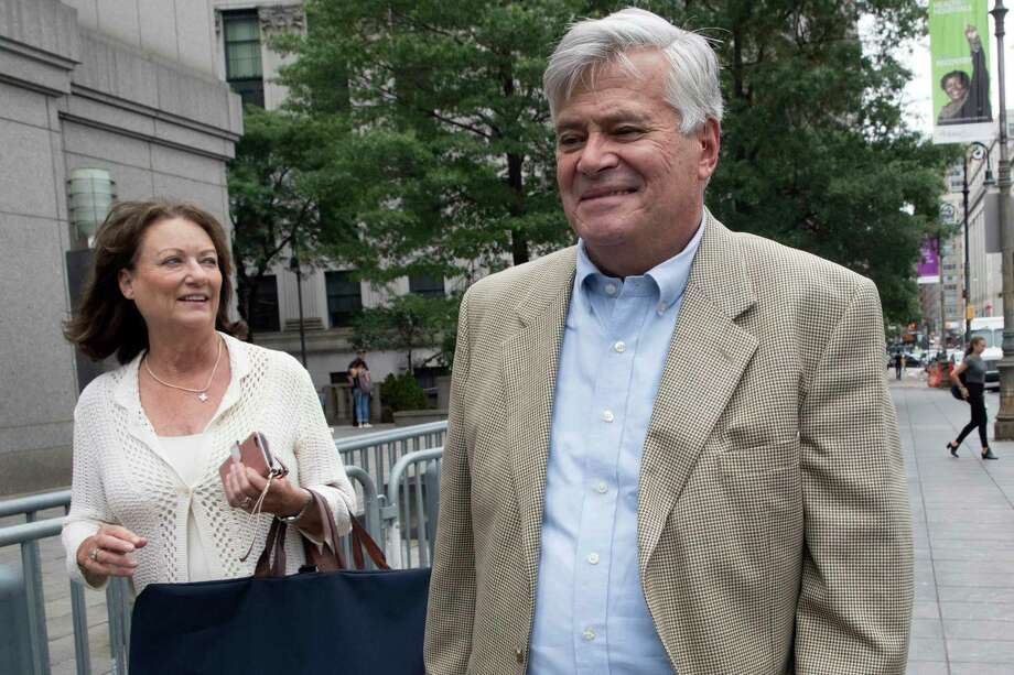Former New York Senate leader Dean Skelos, right, and his wife Gail leave Federal Court, Friday, July 6, 2018, in New York. Skelos, a former New York state Senate leader took the witness stand at his corruption trial on Friday, telling jurors that he used his connections to try to get his sometimes-erratic behaving son employment but insisting it was never in exchange for political favors. (AP Photo/Mary Altaffer) Photo: Mary Altaffer / Copyright 2018 The Associated Press. All rights reserved.
