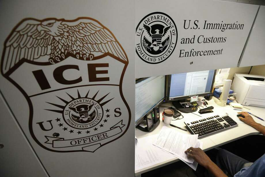 An unidentified Immigration and Customs Enforcement deportation officer reviews forms in 2017 at the the Pacific Enforcement Response Center in Laguna Niguel, Calif. Photo: Allen J. Schaben, FILE / TNS / Los Angeles Times