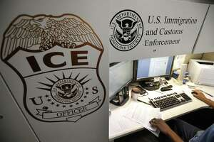 An unidentified Immigration and Customs Enforcement deportation officer reviews forms in 2017 at the the Pacific Enforcement Response Center in Laguna Niguel, Calif.