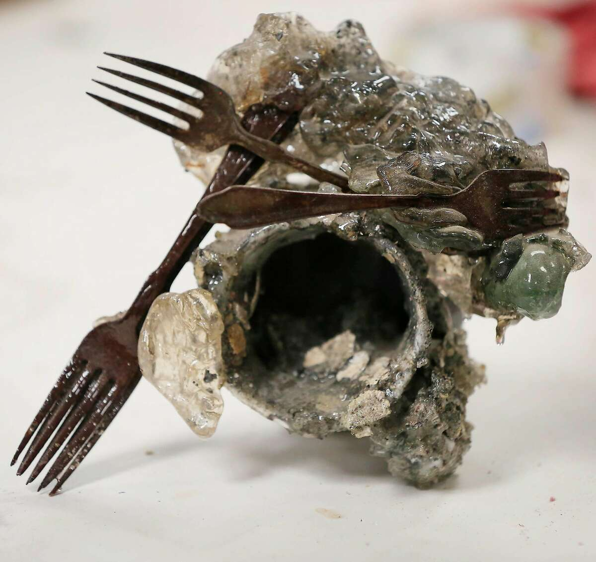A piece of debris from the North Bay fires that Helena Donzelli found on her landlord's property and that she is planning to use in a piece of art sits on a table in the studio on Thursday, July 5, 2018 in Sonoma, Calif.