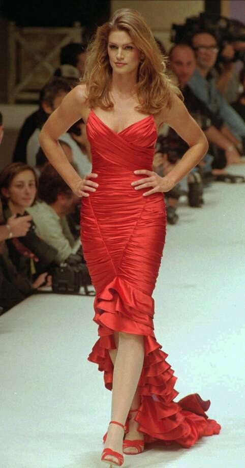 How could you go wrong with a red dress? Photo: Remy De La Mauviniere / Associated Press / ONLINE_YES