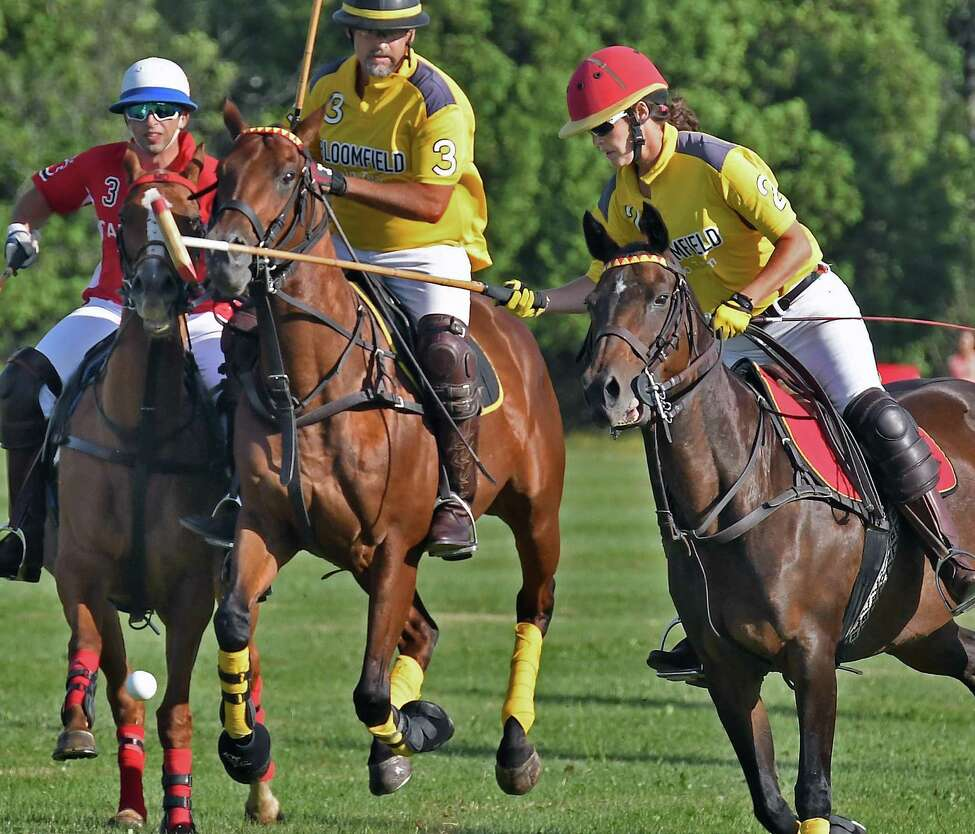 Tab Orthwein, right, and Will Orthwein, center, seen playing polo at Saratoga Polo Club in2018, say EMS coverage of that area of Greenfield needs to be improved. (John Carl D'Annibale/Times Union)