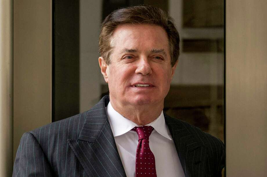 FILE - In this April 4, 2018, file photo, Paul Manafort, President Donald Trump's former campaign chairman, leaves the federal courthouse in Washington. Lawyers for Paul Manafort, President Donald Trump's former campaign chairman, have asked a judge to relocate a criminal trial starting later this month because of pretrial publicity, his lawyers said in court papers Friday, July 6. (AP Photo/Andrew Harnik, File) Photo: Andrew Harnik / Copyright 2018 The Associated Press. All rights reserved.