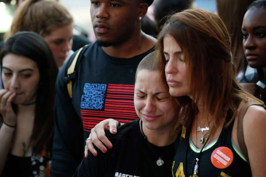 """Anti-gun violence advocate and Marjory Stoneman Douglas High School shooting survivor Emma Gonzales (C) is comforted at the """"End of School Year Peace March and Rally"""" in Chicago on June 15, 2018. A boisterous Chicago rally and march kicked off a national gun-reform tour on Friday by students from Parkland, Florida, site of one of the worst US school shootings.  The students-turned-activists have become powerful national voices with their """"March For Our Lives"""" campaign pushing for reforms of gun laws, following the February 14 mass shooting at Marjory Stoneman Douglas High School, which killed 17 students and school staff.   / AFP PHOTO / JIM YOUNGJIM YOUNG/AFP/Getty Images Photo: JIM YOUNG, Contributor / AFP/Getty Images / AFP or licensors"""