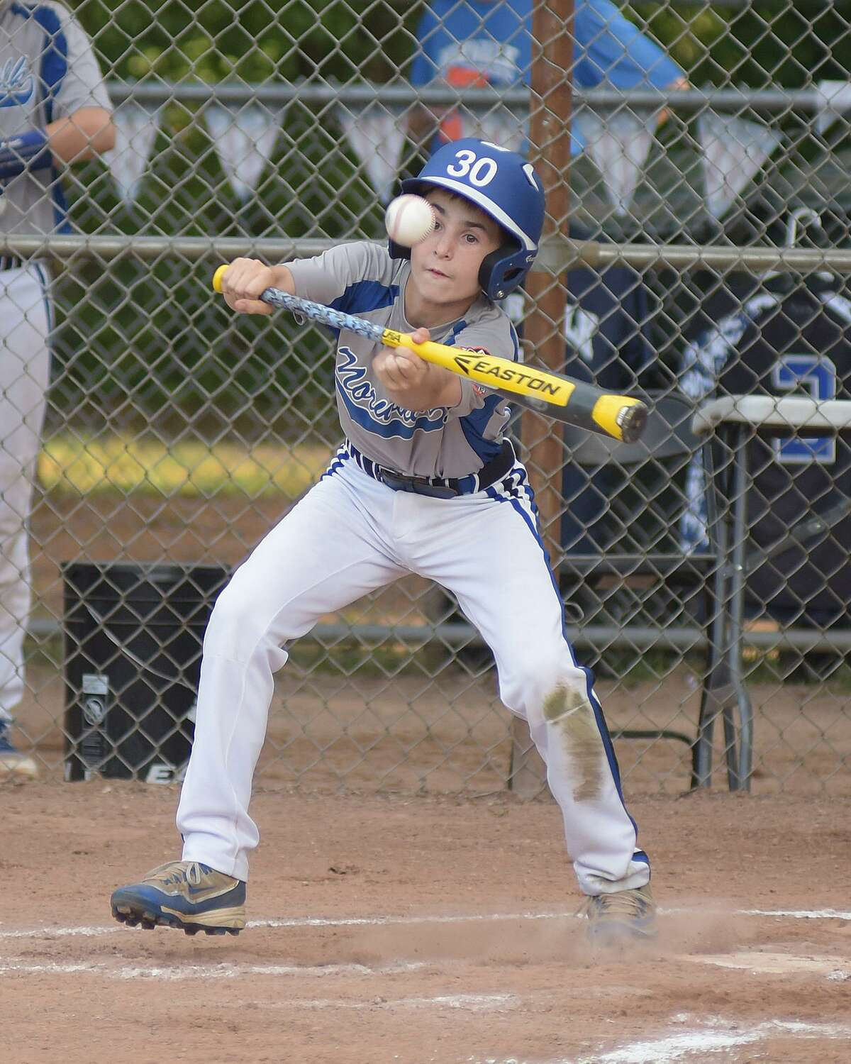 Norwalk's Will Stalzer lays down a bunt during Friday's Cal Ripken 12-year-old All-Star state championship game at Devine Field in Norwalk. Norwalk defeated New Canaan 9-3 to claim its fourth straight age-group state title.