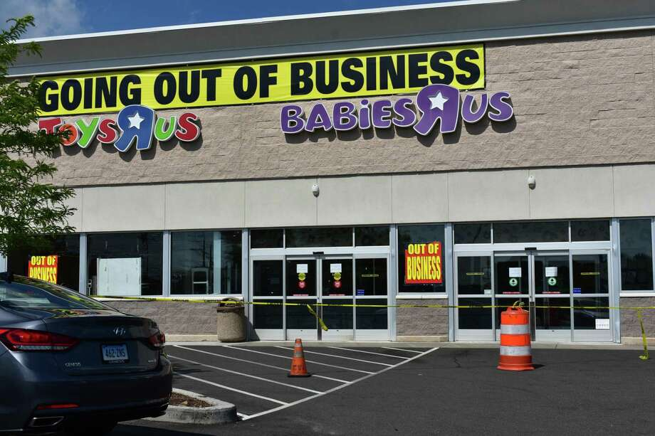 Yellow warning tape that in mid-June 2018 roped off spent aisles at Toys R Us in Norwalk has now moved to front doors, after the 59 Connecticut Ave. store closed its doors on Thursday, June 28, following a bankruptcy dissolution. Photo: Alexander Soule, Business Reporter / Hearst Connecticut Media / Stamford Advocate
