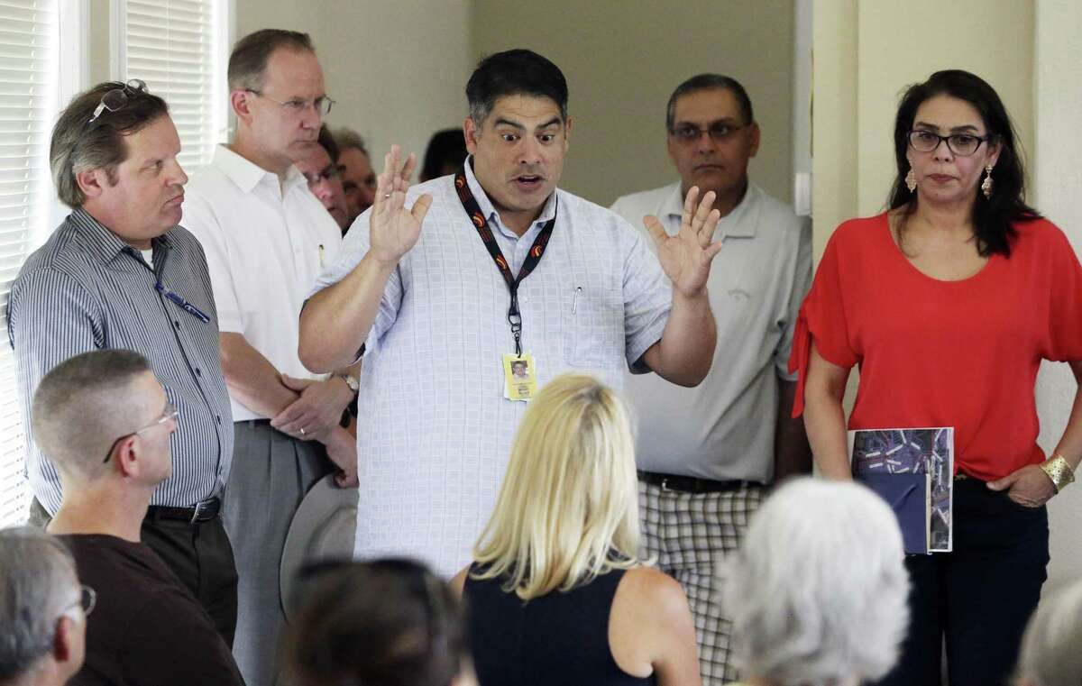 Council person Manny Pelaez explains a point as residents of Legend Hills on the Northwest Side gather to ask questions and hear comments about the Mansions at La Cantera development in their area on July 6, 2018.
