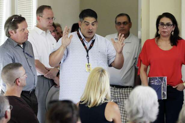 Councilman Manny Pelaez explains a point as residents of Legend Hills on the Northwest Side gather to ask questions and hear comments about the Mansions at La Cantera development in their area on July 6.