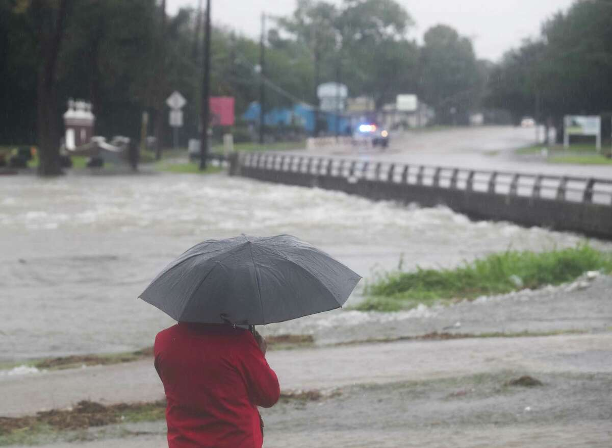 Henry Sanchez looks out along Lawndale Street, over a flooded Brays Bayou, after heavy rains from the remnants of Hurricane Harvey, Saturday, August 27, 2017, in Houston. ( Jon Shapley / Houston Chronicle )