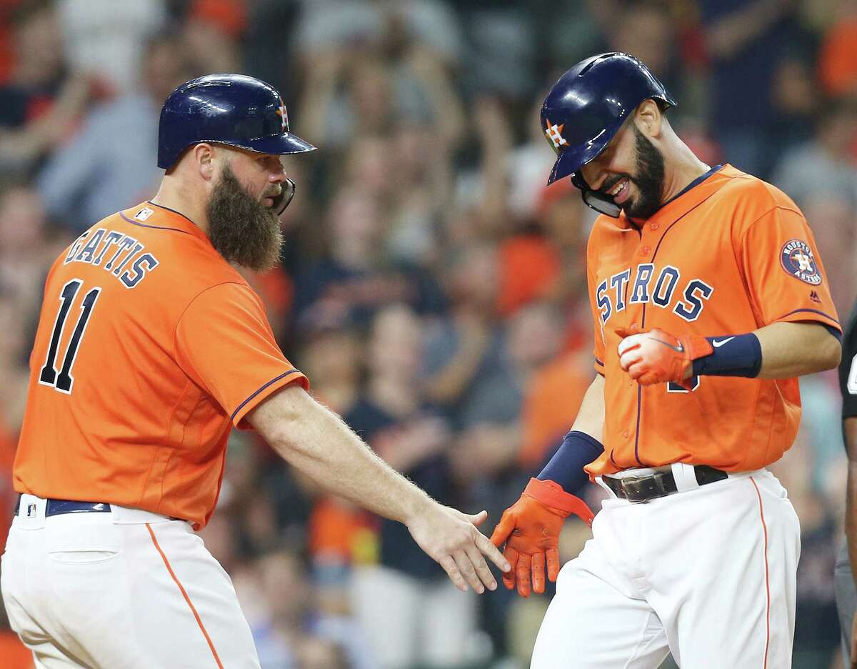 Houston Astros designated hitter Evan Gattis (11) and Marwin Gonzalez (9) congratulated themselves after scoring off of a double by catcher Tim Federowicz (19) in the fourth inning against the Chicago White Sox at Minute Maid Park on Friday, July 6, 2018 in Houston.
