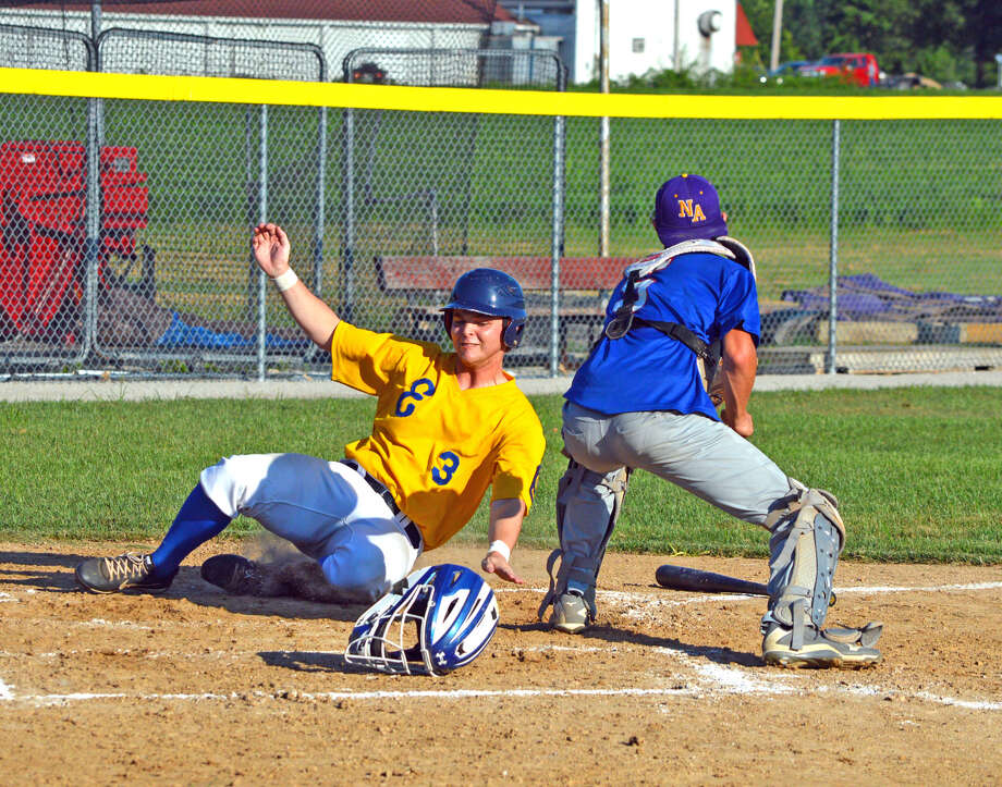 Post 199's Joel Quirin scores on a single by Chase Gockel during the second inning of Friday's game at New Athens.