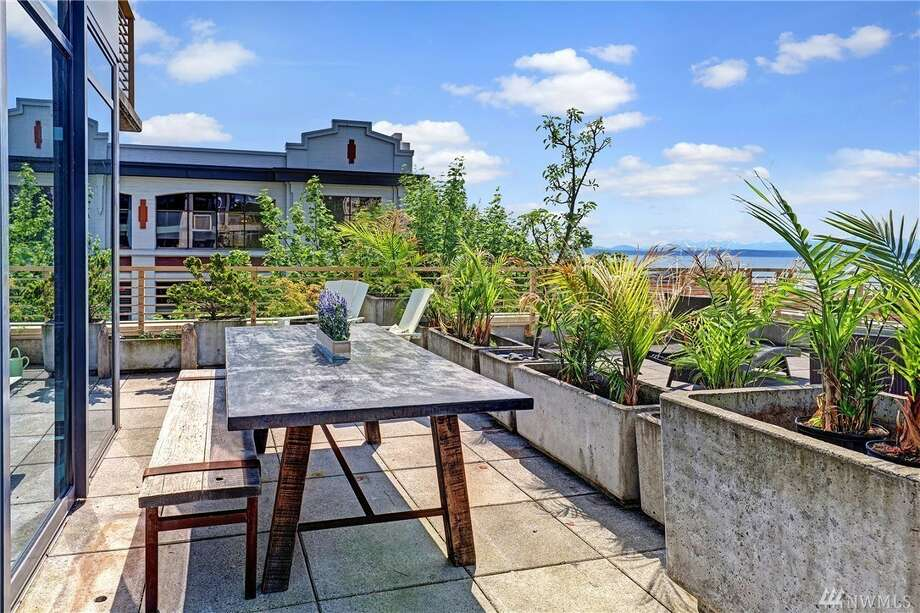Fronted by the Sound, this Belltown corner condo offers sweeping views, and asks $999K. Photo: Engel & Völkers/Mercer Island And Seattle