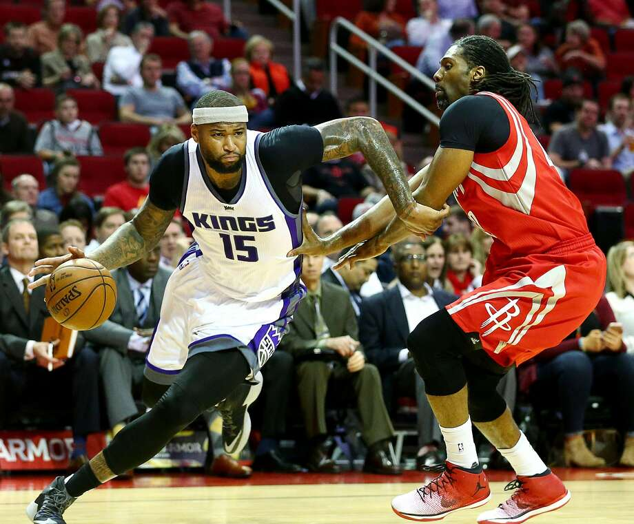 Sacramento Kings forward DeMarcus Cousins (15) tries to drive past Houston Rockets center Nene Hilario (42) on his way to the basket during the first quarter of an NBA game at the Toyota Center, Tuesday, Jan. 31, 2017, in Houston.  Photo: Jon Shapley, Houston Chronicle