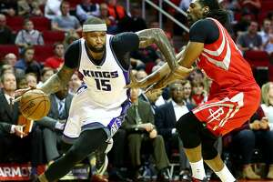Sacramento Kings forward DeMarcus Cousins (15) tries to drive past Houston Rockets center Nene Hilario (42) on his way to the basket during the first quarter of an NBA game at the Toyota Center, Tuesday, Jan. 31, 2017, in Houston. ( Jon Shapley / Houston Chronicle )