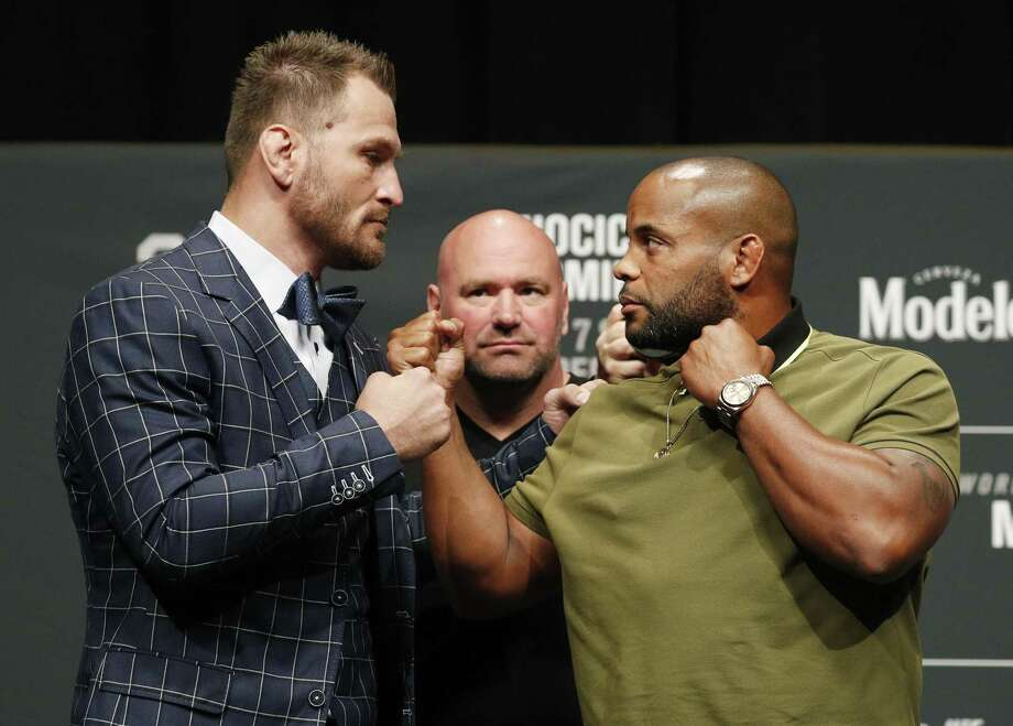UFC president Dana White looks on as Stipe Miocic, left, and Daniel Cormier pose during a press conference Thursday in Las Vegas for UFC 226. They are scheduled to fight for the heavyweight title Saturday. Photo: John Locher /Associated Press / Copyright 2018 The Associated Press. All rights reserved.