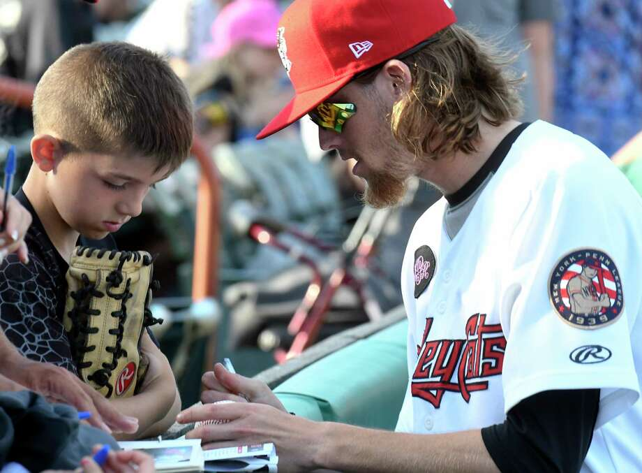 Tri-City ValleyCats pitcher Shawn Dubin (5) signs autographs for fans prior to a minor league baseball game against the Vermont Lake Monsters on Friday, July 6, 2018, in Troy, N.Y. (Hans Pennink / Special to the Times Union) Photo: Hans Pennink / Hans Pennink