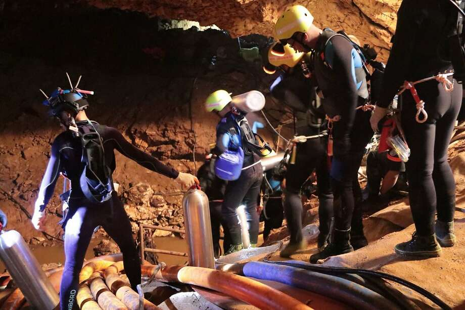 Rescue team members work inside the cave where 12 boys and their soccer coach have been trapped since June 23 in Mae Sai in northern Thailand. Photo: Royal Thai Navy