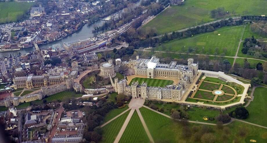 An aerial view shows Windsor Castle, where President Trump will visit with Queen Elizabeth II this week. Scores of protesters are expected in London to demonstrate against Trump. Photo: Owen Humphreys / Associated Press