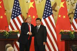 FILE - In this Nov. 9, 2017, file photo, U.S. President Donald Trump and Chinese President Xi Jinping shakes hands during a news conference at the Great Hall of the People in Beijing. Trump�s trade battle with China will exacerbate relations with Beijing that are already fraying on several fronts as the U.S. takes a more confrontational stance and an increasingly powerful China stands its ground. (AP Photo/Andrew Harnik, File)