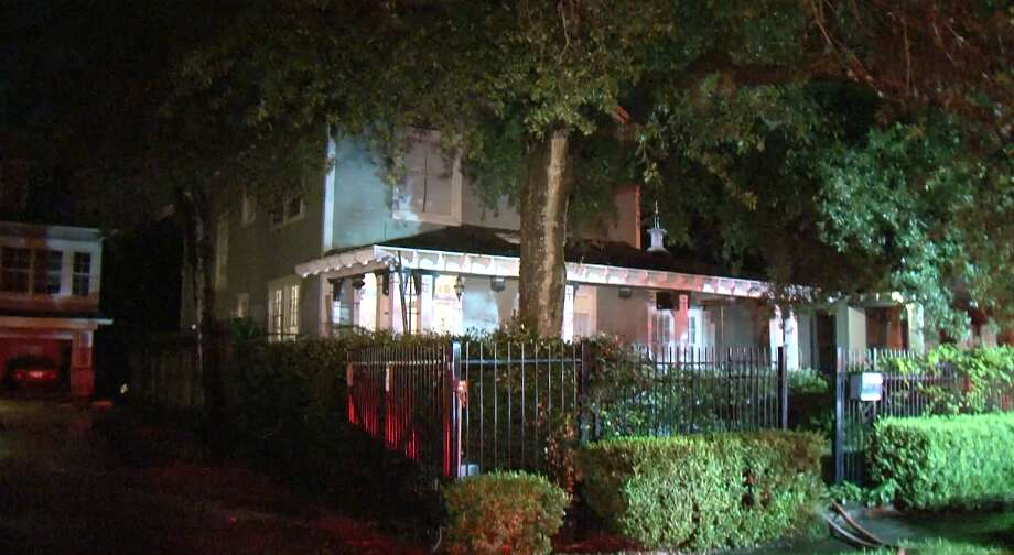 A Midtown home caught fire after being struck by lightning Friday night, the Houston Fire Department said. Photo: Metro Video