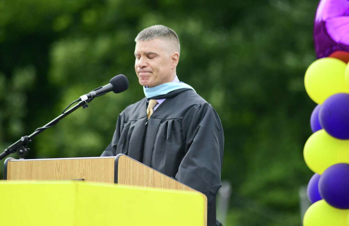 Principal Michael Rinaldi fights back his emotions as he addresses the graduates during Westhill High School Class of 2018 commencement exercises on June 22, 2018 in Stamford, Connecticut.
