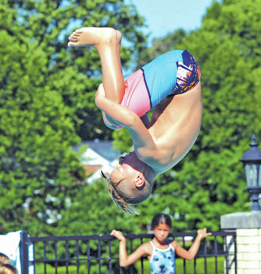 Summers Port's Luke Davis executes a dive during the 9-10 boys division at the Sunset Hills Invitational Dive Meet on Saturday in Edwardsville. Photo:       Scott Marion / Hearst Newspapers