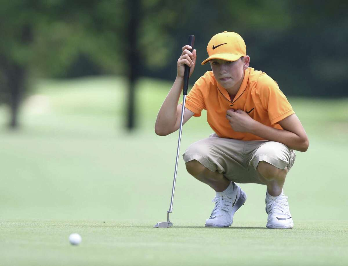 Ben James, 13, of Great River Golf Club in Milford, lines up a putt during the 2016 Connecticut Open.