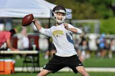Quarterback Finn Signer of the Brunswick School passes  during the 11th Annual Grip It and Rip It competition on Saturday July 7, 2018 at New Canaan High School in New Canaan, Connecticut.