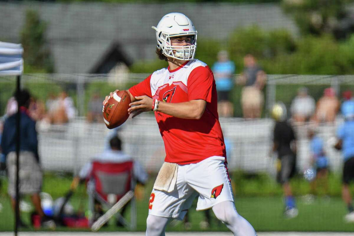 Quarterback Gavin Muir of the Greenwich Cardinals looks to pass during the 11th Annual Grip It and Rip It competition on Saturday July 7, 2018 at New Canaan High School in New Canaan, Connecticut.