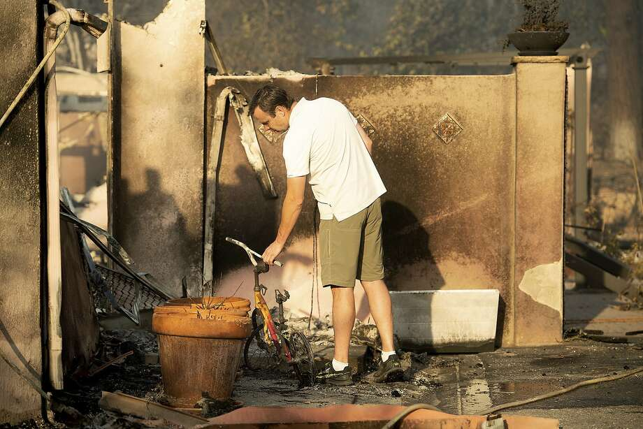 Eric Durtschi examines the remains of his home scorched by fire in Goleta (Santa Barbara County). Photo: Noah Berger / Associated Press