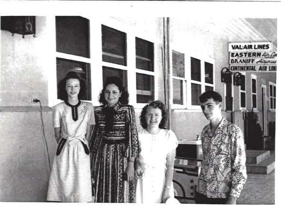 Family and friends gather at the original terminal of San Antonio Municipal Airport, likely sometime in the late 1940s. Left to right are Sissy Cullinane; Sissy's sister Annie Cullinane; Annie's best friend Cecilia Dunk; and Mike Cullinane, brother of the first two young women. Photo: Courtesy / Edward M. Lavin