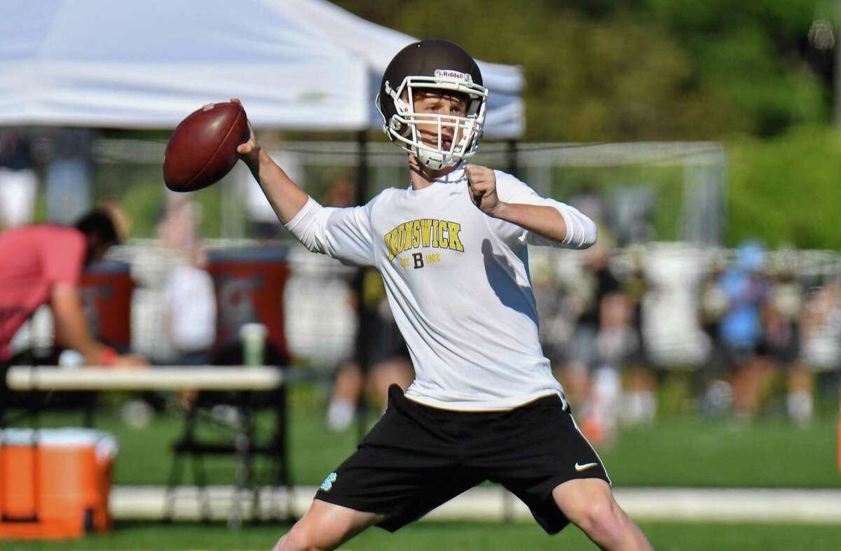 Brunswick quarterback Finn Signer takes part in the 11th Grip It and Rip It tournament on Saturday at New Canaan High.
