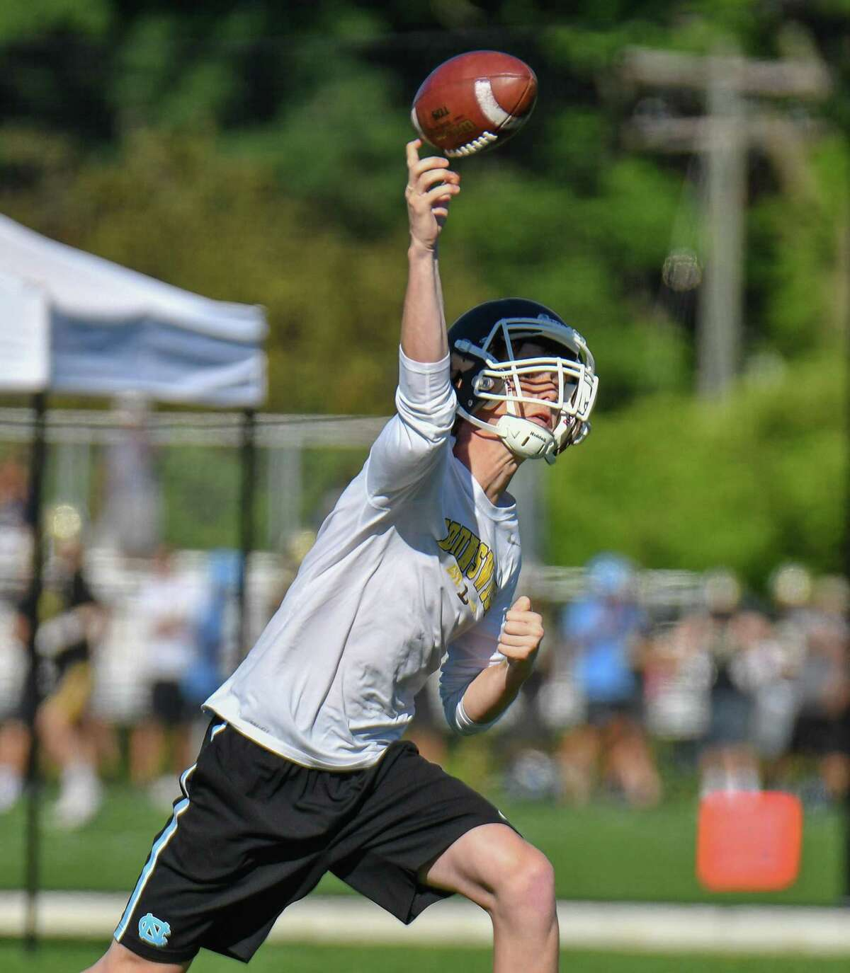 Quarterback Fin Signer of the Brunswick School passes during the 11th Annual Grip It and Rip It competition on Saturday July 7, 2018 at New Canaan High School in New Canaan, Connecticut.