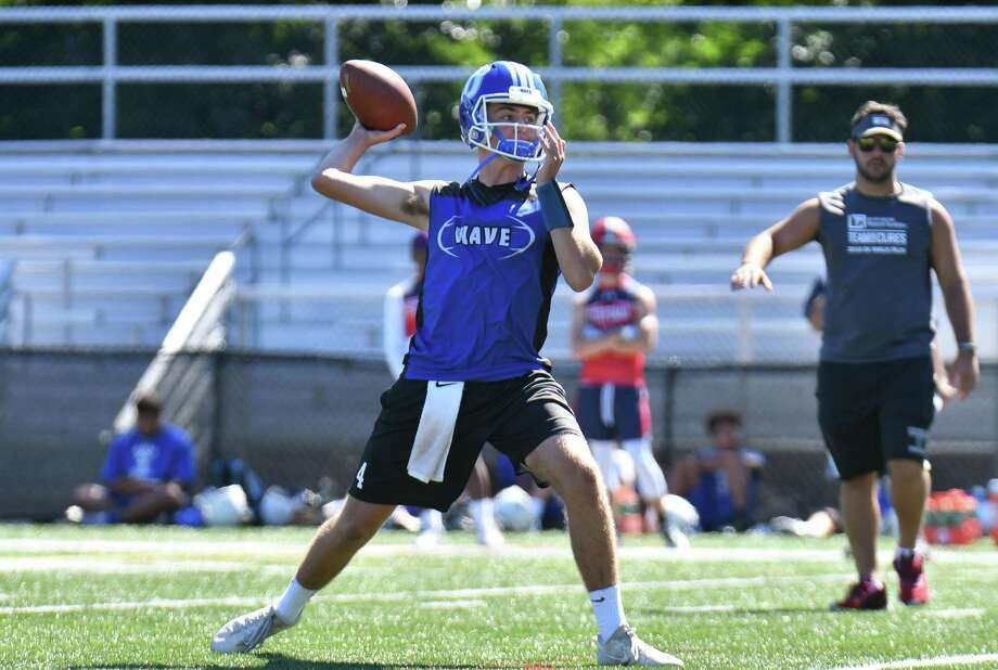 Quarterback Cooper Hancock of the Darien Blue Wave passes during the 11th Annual Grip It and Rip It competition on Saturday July 7, 2018 at New Canaan High School in New Canaan, Connecticut. Photo: Gregory Vasil / For Hearst Connecticut Media / Connecticut Post Freelance