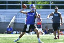 Quarterback Cooper Hancock of the Darien Blue Wave passes during the 11th Annual Grip It and Rip It competition on Saturday July 7, 2018 at New Canaan High School in New Canaan, Connecticut.