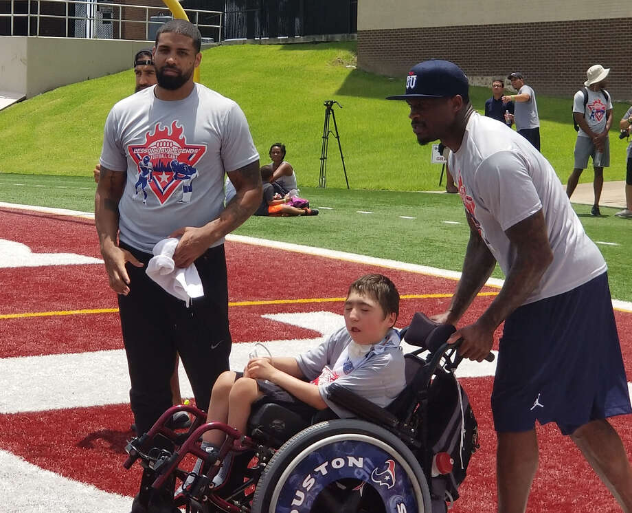 Retired Texans Andre Johnson and Arian Foster hosted Lessons by Legends youth football camp to youngsters. Photo: Aaron Wilson/Houston Chronicle
