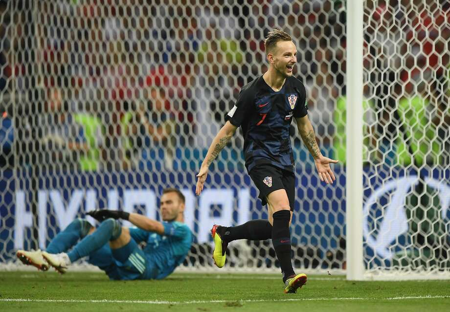 Ivan Rakitic celebrates scoring the winning penalty past Russia goalkeeper Igor Akinfeev, getting Croatia to the semifinals. Photo: Shaun Botterill / Getty Images