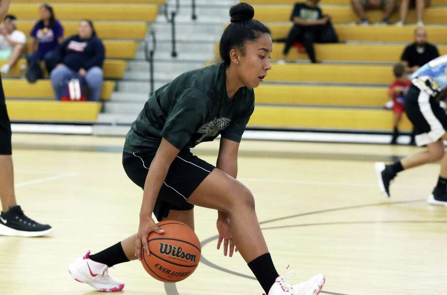 Vivianna Solis practices between the feet dribbling as the Lady Hoops basketball club practices at St. Luke Catholic Schol on July 5, 2018. Photo: Tom Reel, Staff / San Antonio Express-News / 2017 SAN ANTONIO EXPRESS-NEWS