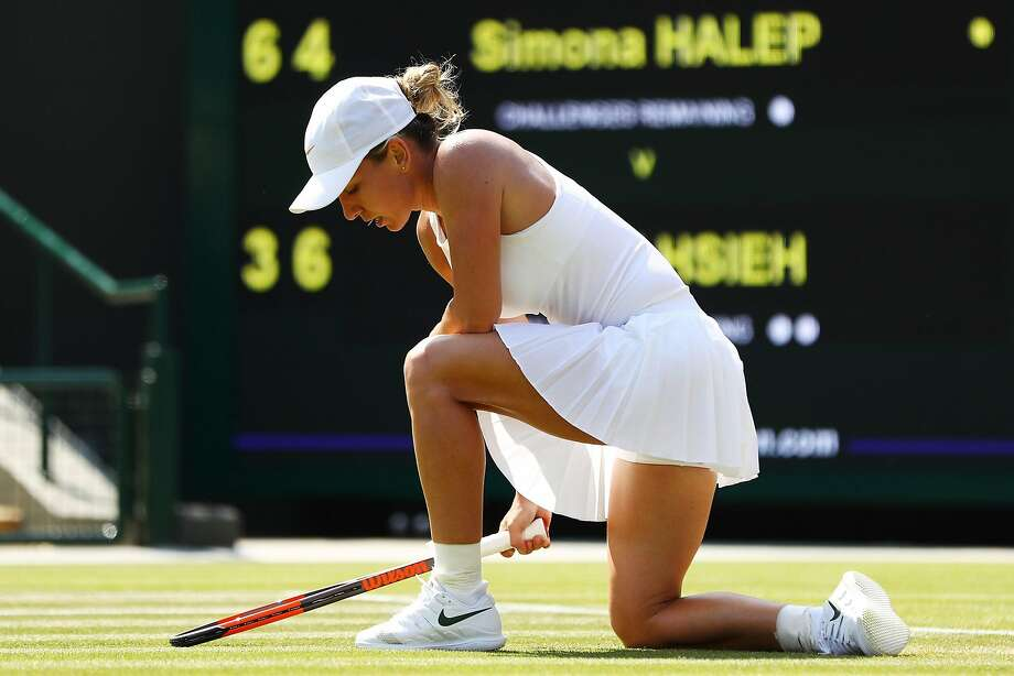 LONDON, ENGLAND - JULY 07:  Simona Halep of Romania appears dejected during her Ladies' Singles second round match against Su-Wei Hsieh of Taiwan on day six of the Wimbledon Lawn Tennis Championships at All England Lawn Tennis and Croquet Club on July 7, 2018 in London, England.  (Photo by Michael Steele/Getty Images) Photo: Michael Steele, Getty Images