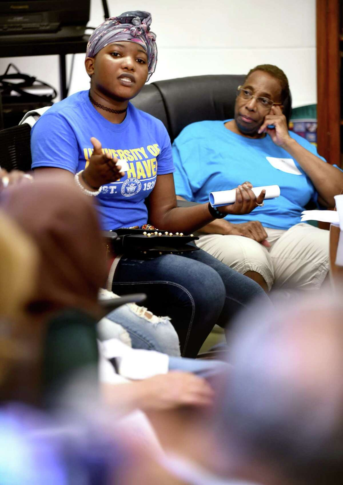 """Divine Mahoundi (left) of the Republic of Congo asks a question of senior pastor Frederick ?'Jerry?"""" Streets during a discussion about racial history in the United States at the Dixwell Avenue Congregational United Church of Christ in New Haven on June 29, 2018."""