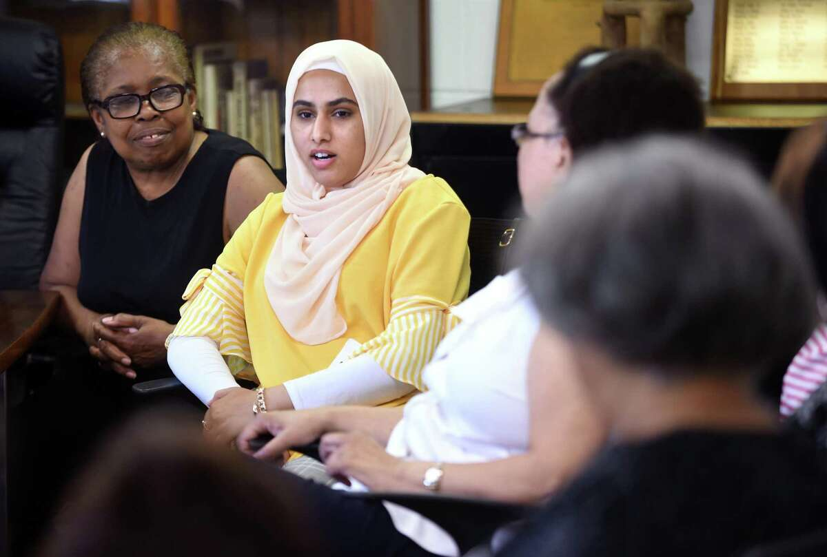 Noor Roomi (center) from Iraq introduces herself during a discussion about racial history in the United States at the Dixwell Avenue Congregational United Church of Christ in New Haven on June 29, 2018.
