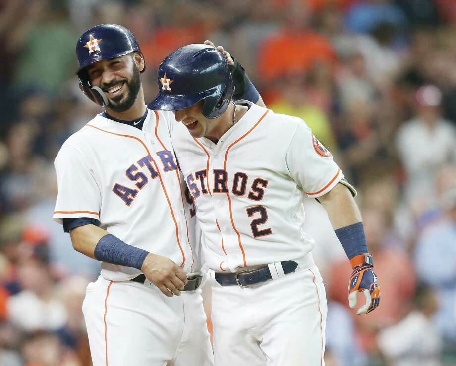 Houston Astros shortstop Marwin Gonzalez (9) celebrates Houston Astros third baseman Alex Bregman (2) two-run home run in the bottom of the six inning, making the score 8-5 Astros. Houston Astros host Chicago White Sox at Minute Maid Park on  Saturday, July 7, 2018 in Houston. Photo: Elizabeth Conley, Houston Chronicle / ©2018 Houston Chronicle